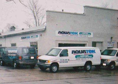 aquatek van in front of building